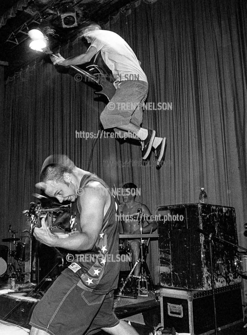 Bass player jumps from amp at Grimlock at the Tower Theater.