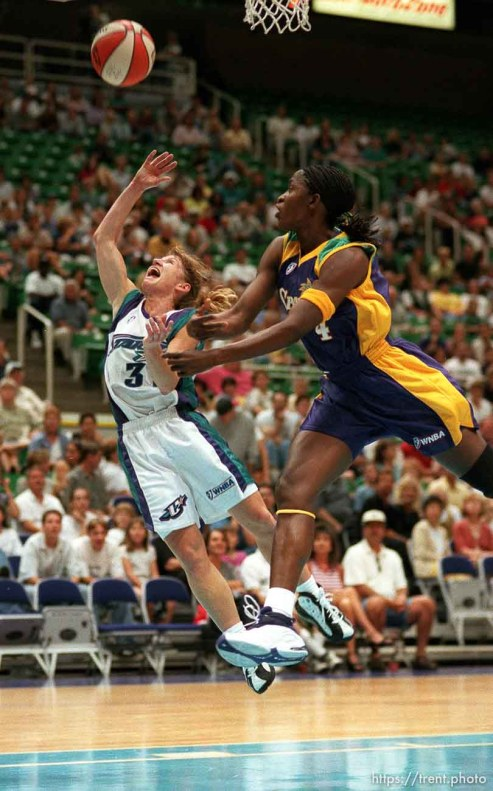 Debbie Black of the Utah Starzz puts up a layup in action vs. the Los Angeles Sparks. Mwadi Mabika is the defender (at right)