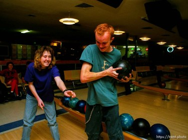 Disabled kids bowling and playing videogames.