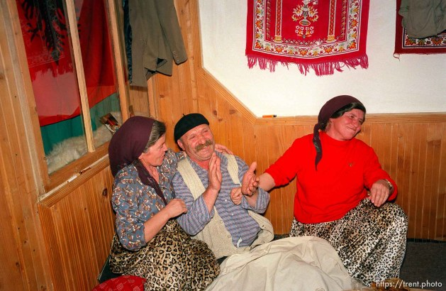 Skender Hoxha and his two wives, who are also sisters, at a traditional dinner with the Hoxha family.