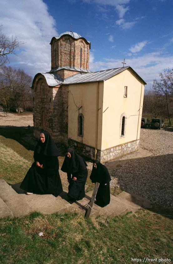 Three Serbian nuns and their 14th Century Orthodox Church, now guarded by KFOR soldiers.