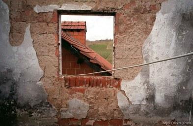 A view through the ruins of Anton Selitaj's home, destroyed by Serbs.