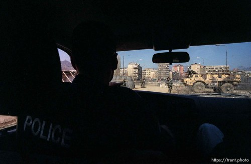 UNMIK police officer Zane Smith drives to the north, Serbian side of Mitrovica across the main bridge.