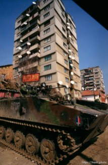 KFOR armored vehicle and a high-rise in north Mitrovica