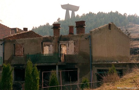 Destroyed buildings in North Mitrovica. Monument to miners on the hill.