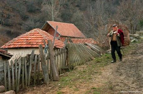 Serbian man walking down a road in a hillside village in Northern Kosovo