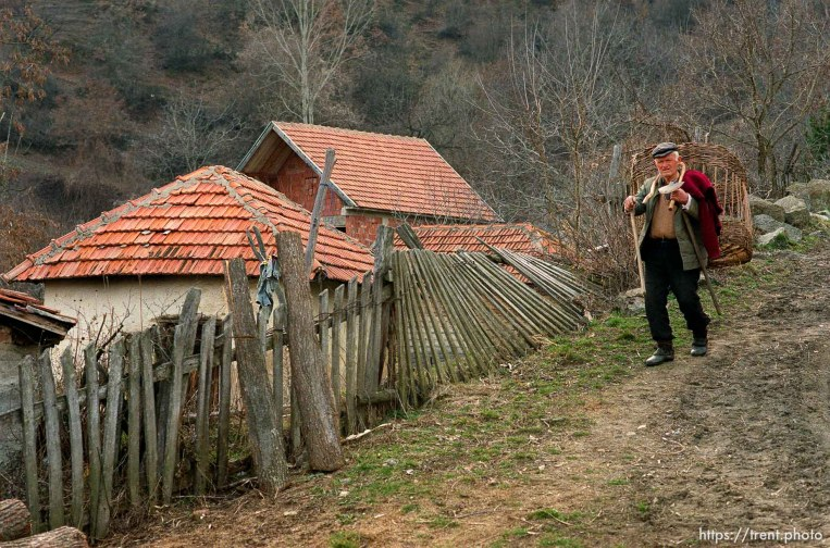 Serbian man walking down a road in a hillside village in Northern Kosovo