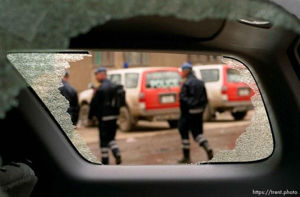 Broken windows in a UNMIK police vehicle.