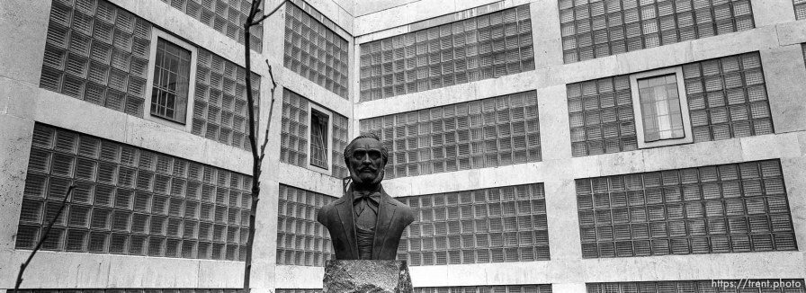 Bust and building.