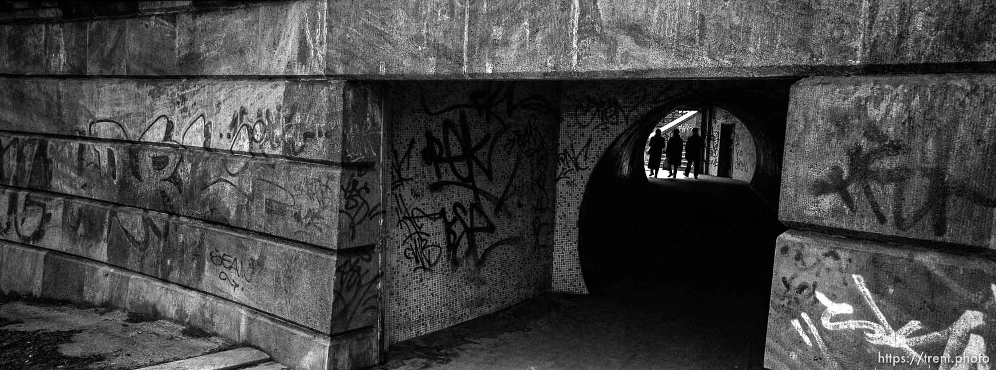 Pedestrians, graffiti, tunnel