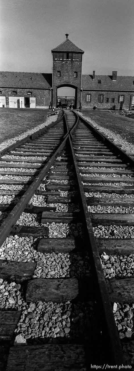"""Rails and the """"Death Gate"""" guard tower at the Birkenau Concentration Camp."""