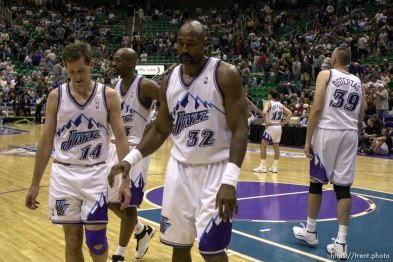 Jeff Hornacek, Bryon Russell, Karl Malone, John Stockton, Greg Ostertag walk off the floor at the end at Utah Jazz vs. Portland Trailblazers. Game 3, 2nd round NBA Playoffs. Trailblazers won to take 3-0 advantage in series, which they eventually won.