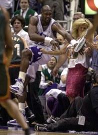 Karl Malone collides with colorful Sonics fan Brina Sanft at Jazz vs. Sonics, game 5, 1st round NBA playoffs. Jazz won.