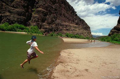 Mikey Hightower jumps into the river on a Native American river trip through Lodore Canyon and Dinosaur National Monument.