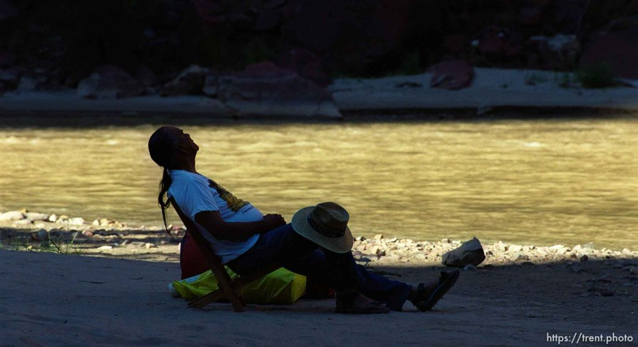 Clifford Duncan relaxing at the river's edge at the Wild Mountain campground on a Native American river trip through Lodore Canyon and Dinosaur National Monument.