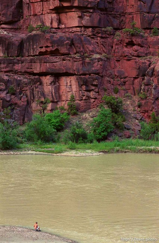 Mikey Hightower fishes at the Wild Mountain campground on a Native American river trip through Lodore Canyon and Dinosaur National Monument.