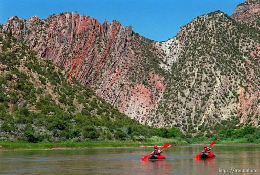 Bob Ligon and Kris Ligon (Houston, TX) riding inflatable kayaks on a Native American river trip through Lodore Canyon and Dinosaur National Monument.