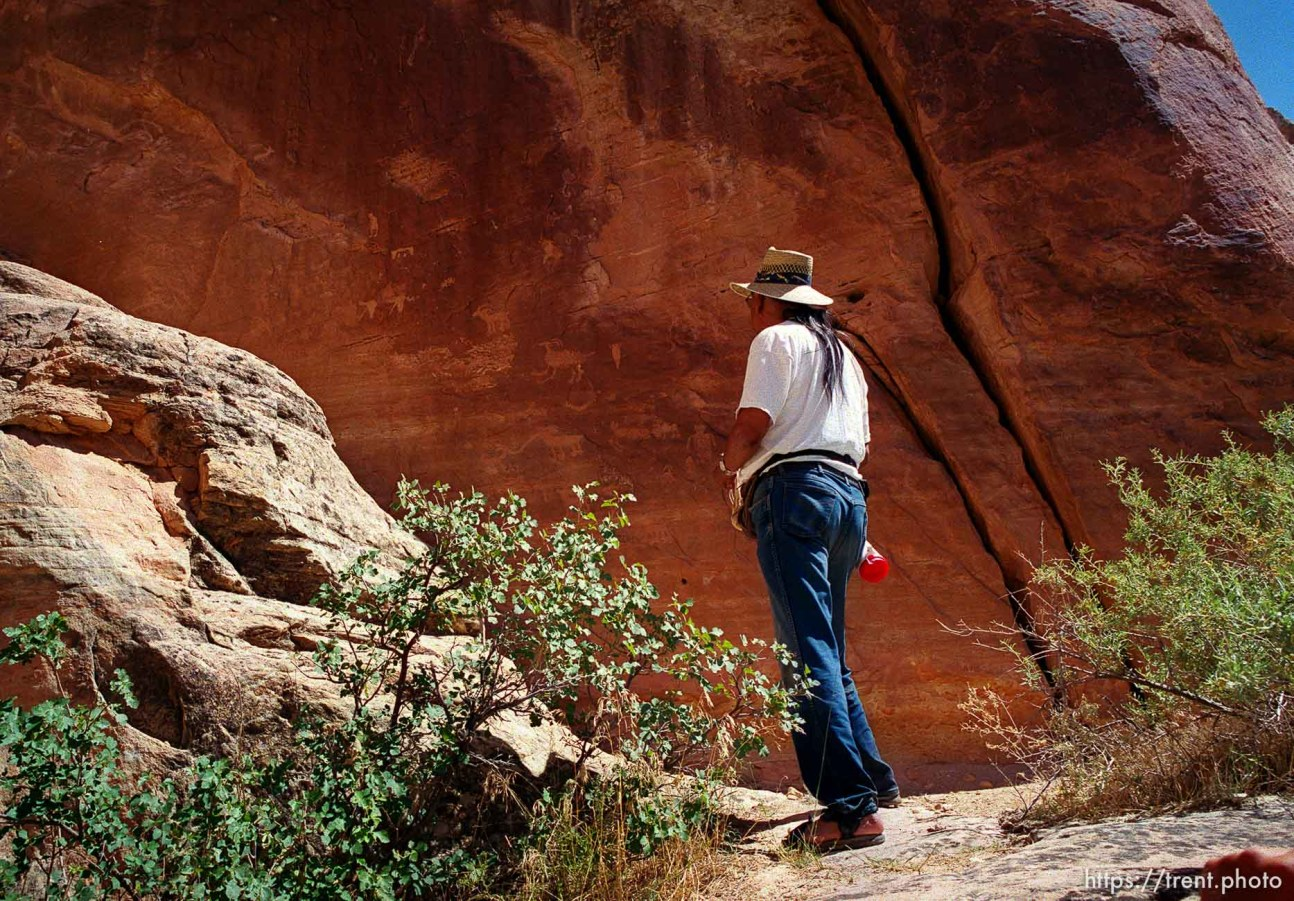 Clifford Duncan next to a wall of petroglyphs at Echo Park on a Native American river trip through Lodore Canyon and Dinosaur National Monument.