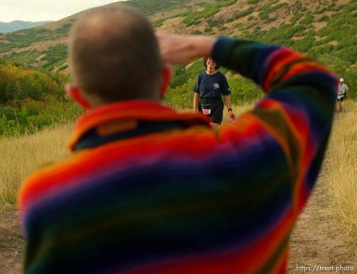 David Wick takes a photograph of his friend Monica Scholz near the Lambs Canyon aid station. Wasatch 100 Endurance Run.