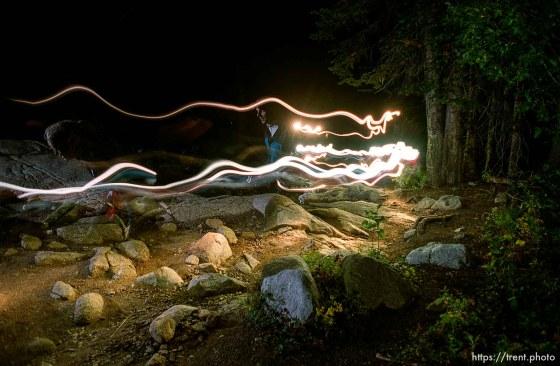 Flashlights light the trail near Brighton. Wasatch 100 Endurance Run.