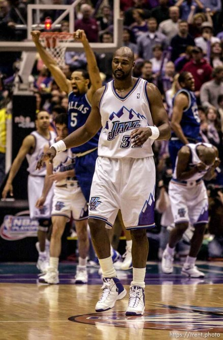 Karl Malone walks off the court after missing the last shot, giving Dallas the series victory. as the Utah Jazz face the Dallas Mavericks in game five of their first round playoff series, in Salt Lake City Thursday. 05/03/2001
