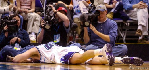 Greg Ostertag, injured on court. Jazz host the Philadelphia 76ers Saturday night at the Delta Center. Jazz win. 12.29.2001, 8:06:52 PM