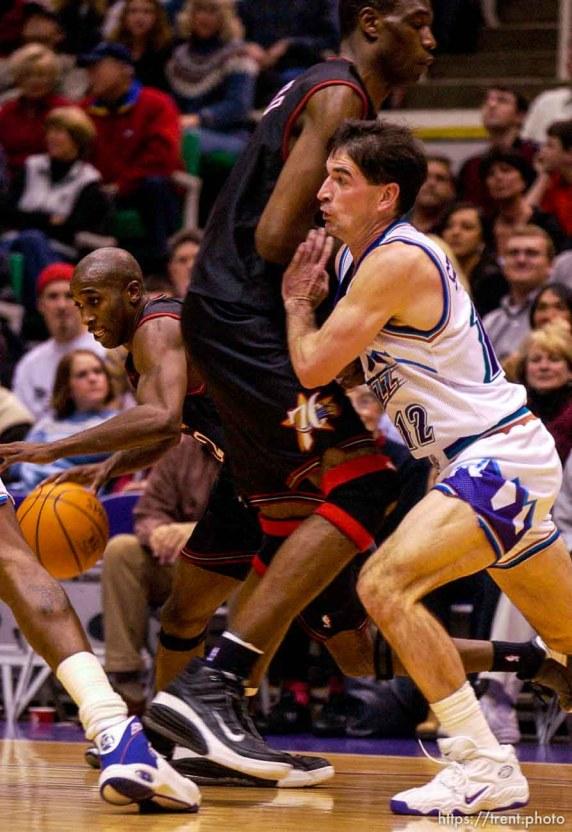 John Stockton fights through a pick. Jazz host the Philadelphia 76ers Saturday night at the Delta Center. Jazz win. 12.29.2001, 9:27:20 PM