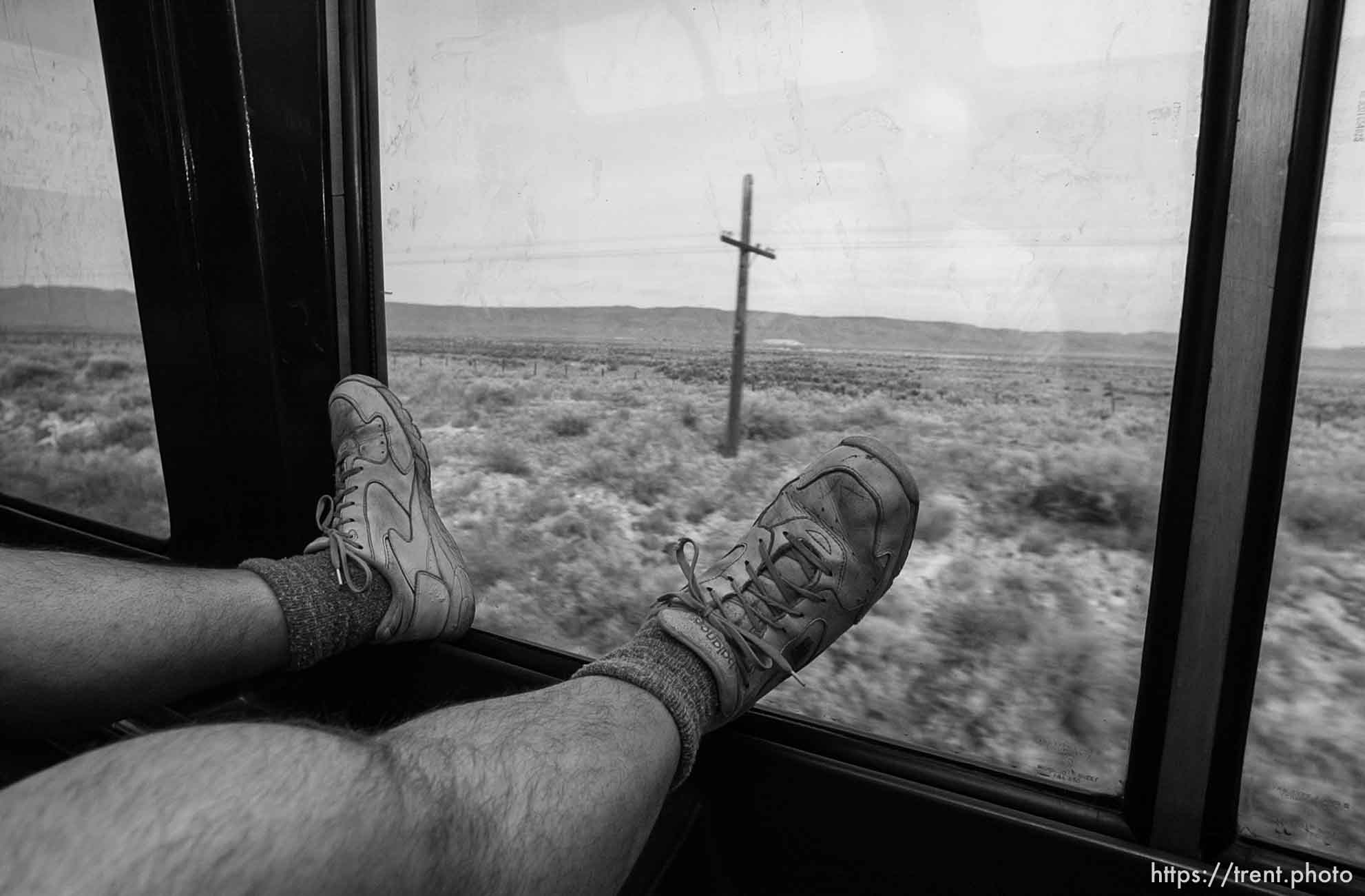 With his legs up on the window in the observation car is Rich, a Sacramento man who frequently rides from California to Boston; 03.28.2002, 9:41:05 AM