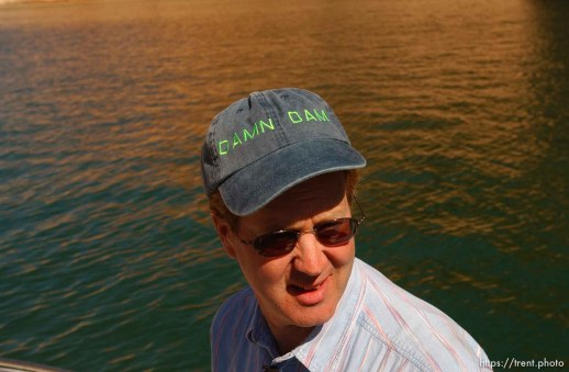 """Wearing a hat labelled """"Damn Dam"""" is Richard Ingebretsen, founder and president of the Glen Canyon Institute. Landmarks which had previously been submerged in Glen Canyon are now becoming visible with the lower water levels in Lake Powell."""