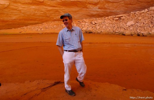 Richard Ingebretsen, founder and president of the Glen Canyon Institute, in Davis Gulch, Lake Powell. Landmarks which had previously been submerged in Glen Canyon are now becoming visible with the lower water levels in Lake Powell. Photo by Trent Nelson; 05.10.2003, 4:50:47 PM