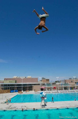 Leaping off the ten meter platform at the Kearns Oquirrh Park Fitness Center in Kearns Wednesday afternoon.