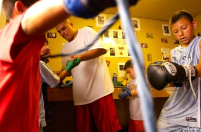 Boxer Gary Gomez and kids training at the gym in his garage.