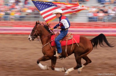 US american flag enters and leaves the arena. West Jordan's Western Stampede rodeo. After 50 years in West Jordan, voters rejected a proposition for a new rodeo grounds, putting the future of the event in question