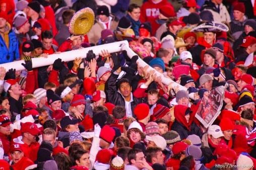 Utah fans swarm the field and down the goalposts. Utah vs. BYU college football. 11.20.2004