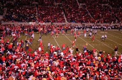 fans swarm the field. Utah vs. BYU college football. 11.20.2004