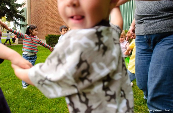 kids dancing in a circle, ring. Midvale Elementary held a Cinco de Mayo celebration Thursday afternoon, as students enjoyed the mariachi band Sol de Jalisco. 05/05/2005