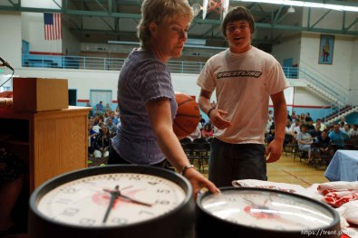 School counselor Karee Hunt, left, helps run a raffle as the school year ends. Students (like Curtis Huitt, right) won prizes including clocks from the school's classrooms and basketballs with the school's logo. The small town of Sunnyside's East Carbon High School is being closed. The students will be transfered to Price's Carbon High School, a 25-minute bus ride away..