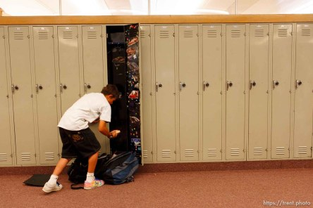 7th grader Cole Hunt clears out his locker. The small town of Sunnyside's East Carbon High School is being closed. The students will be transfered to Price's Carbon High School, a 25-minute bus ride away.
