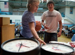 School counselor Karee Hunt, left, helps run a raffle as the school year ends. Students (like Curtis Huitt, right) won prizes including clocks from the school's classrooms and basketballs with the school's logo. The small town of Sunnyside's East Carbon High School is being closed. The students will be transfered to Price's Carbon High School, a 25-minute bus ride away.