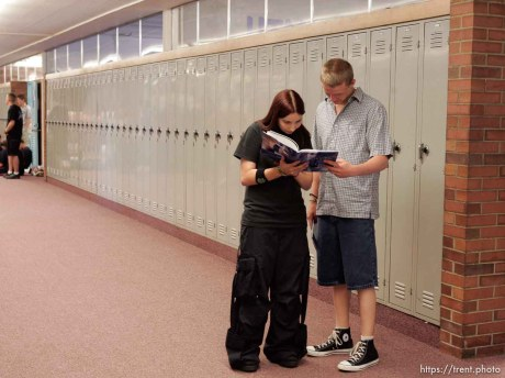 Aubrey Jaramillo, left, and Jacob Perry check out the newly distributed yearbook at East Carbon High School. The small town of Sunnyside's East Carbon High School is being closed. The students will be transfered to Price's Carbon High School, a 25-minute bus ride away.