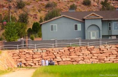 People in field. Colorado City/Hildale.