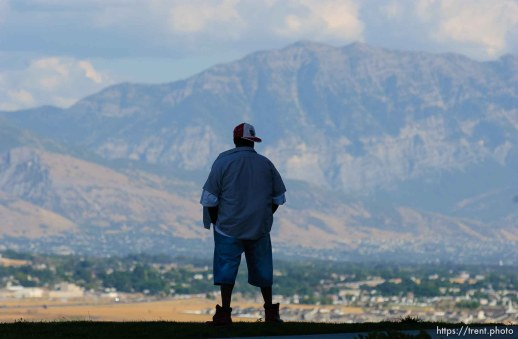 "Cedric Webb of New Orleans takes in his last view of the Wasatch Mountains before boarding a bus to begin his trip to Nashville, Tennessee where he will reunite with family members he was split up from by the hurricane Katrina disaster. ""It's just beautiful,"" he said. ""I came out here every day to feel the air."" About 100 of the 600 or so evacuees housed at Camp Williams boarded buses to Dallas, Texas Wednesday evening. From Dallas, they will make they way to a variety of locations and reunite with friends and family members."
