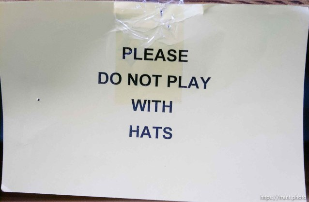 please do not play with hats sign. Salt Lake Costume Co., founded in 1889, closed Saturday, and sold its remaining property at an auction Tuesday. Rob Olson was the auctioneer.