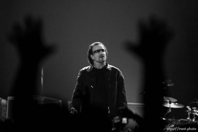 U2 performs at the Delta Center.