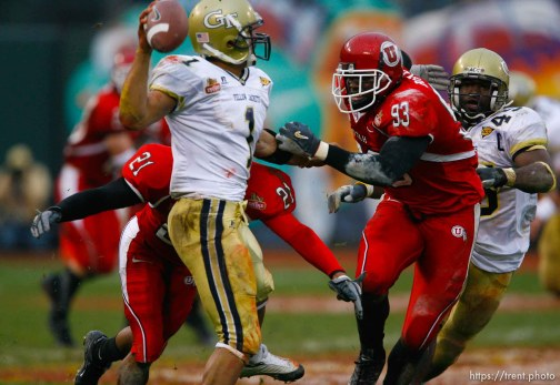 Utah's Shaun Harper (left) and Martail Burnett pressure Georgia Tech QB Reggia Ball. Ball threw the ball away. University of Utah vs. Georgia Tech, Emerald Bowl, San Francisco.