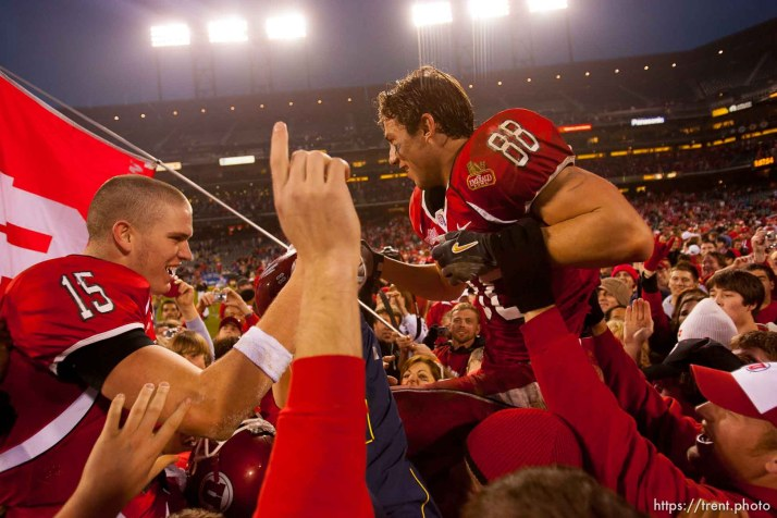 Utah quarterback Brett Ratliff and Travis LaTendresse (right) are lifted up by fans after the win. University of Utah vs. Georgia Tech, Emerald Bowl, San Francisco.
