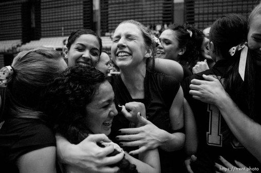 Orem - Cottonwood's Kylie Hudson (right) hugs teammate Trustine Mendoza as the team celebrates their state championship. Cottonwood defeats Murray for the 4A state championship, girls high school volleyball at UVSC.