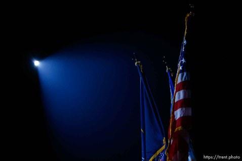 us flag under spotlight during national anthem