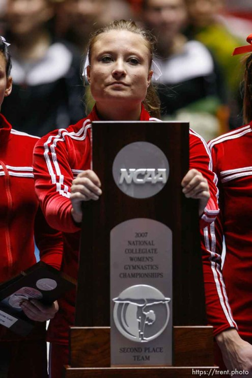 utah's nicolle ford with second place trophy. NCAA Women's Gymnastics Championships at the Huntsman Center
