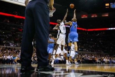Utah Jazz forward Carlos Boozer (5) shoots over San Antonio Spurs center Francisco Elson (16) San Antonio - Utah Jazz vs. San Antonio Spurs, NBA basketball, Western Conference Finals Game One. 5.20.2007